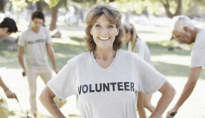 senior volunteer lady looking at the camera in a park