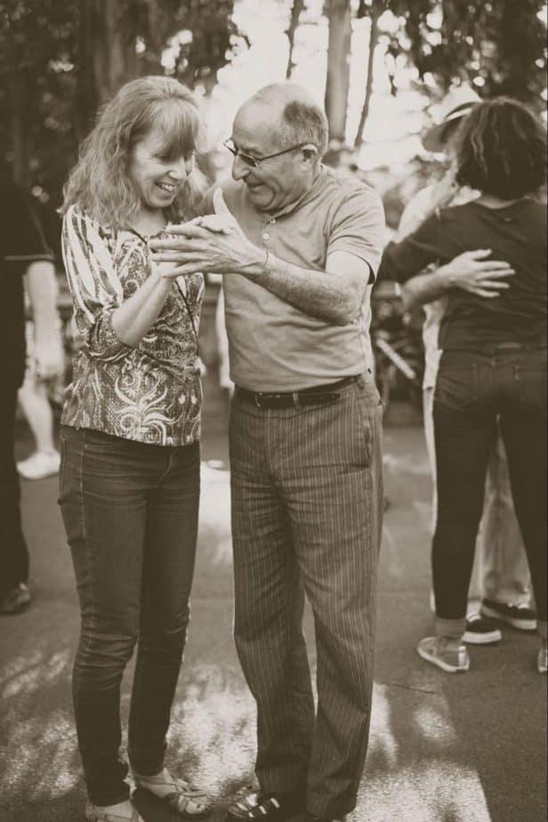 senior. couple dancing outside