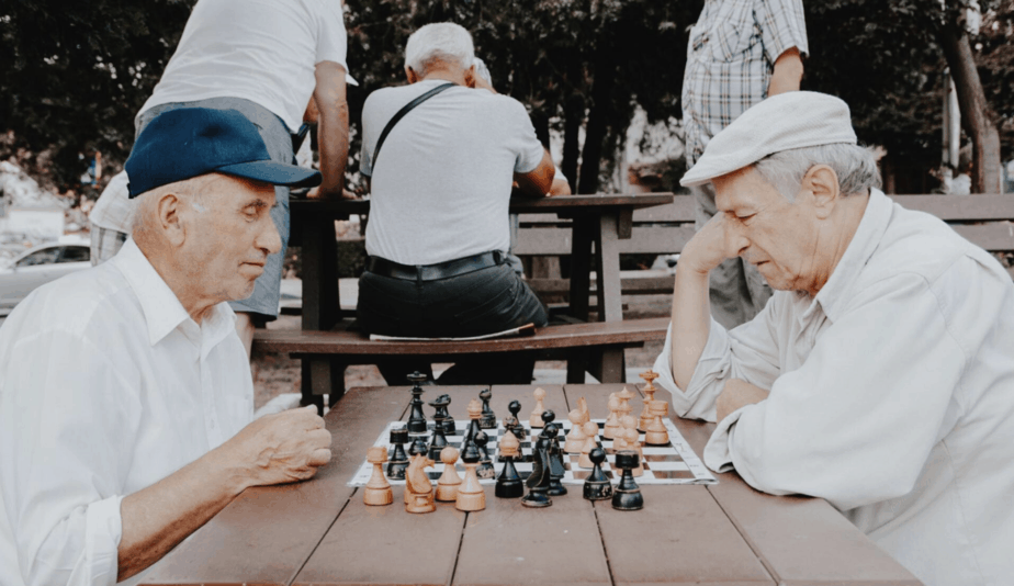 two seniors playing chess