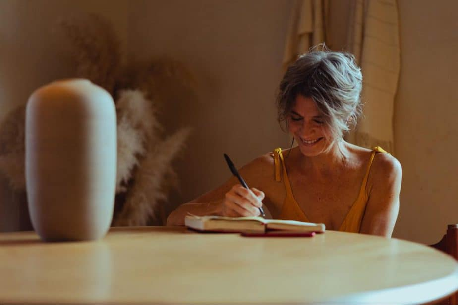 woman writing in a gratitude journal