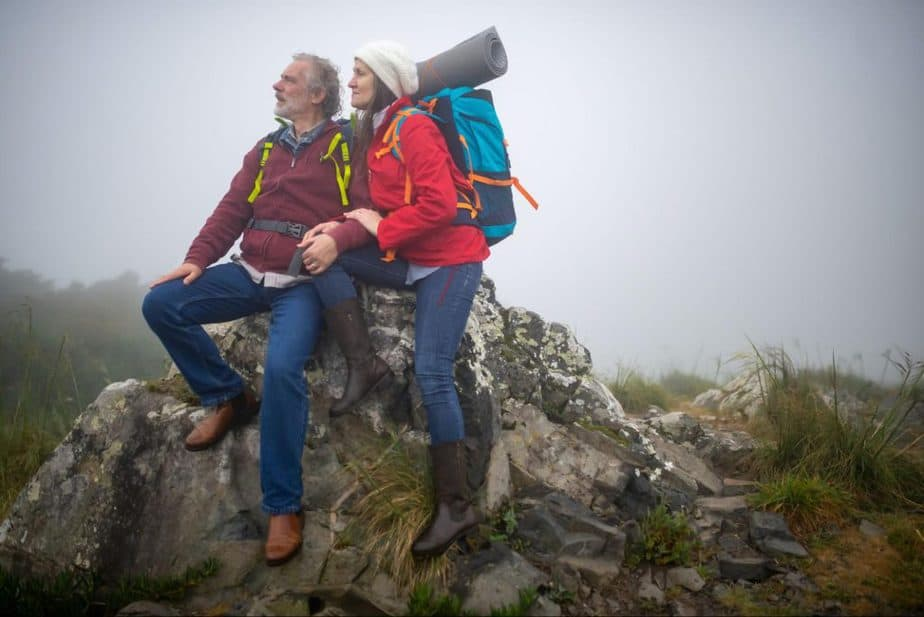 old couple on top of a mountain