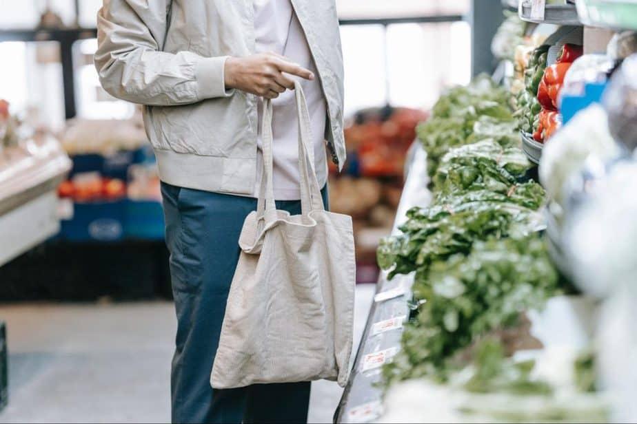 man shopping for leafy vegetables