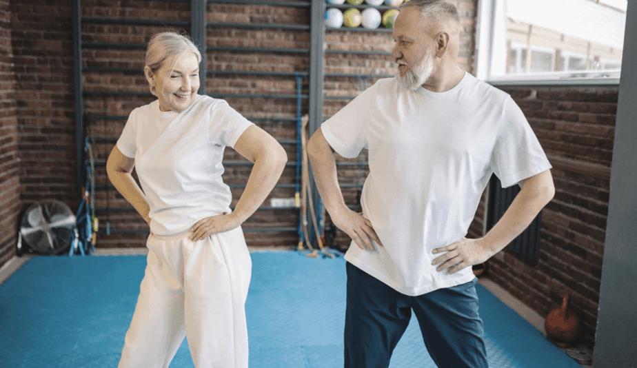 senior couple exercising in the gym