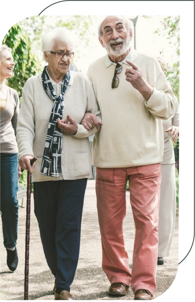 senior couple holding hands and walking in the park