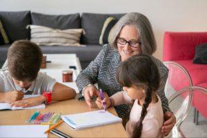 Senior woman drawing with her grandchildren
