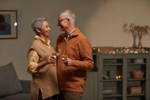 senior couple drinking wine and bonding