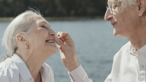 senior couple laughing and enjoying at a body of water